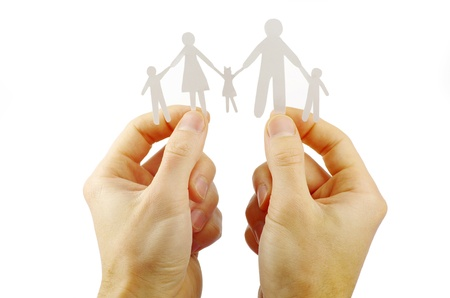 Paper family in hands isolated on white background Stock Photo - 11185558