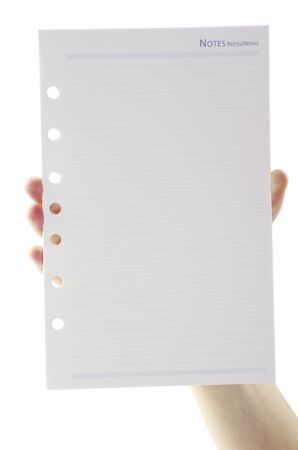 Page of block notes in hand isolated in white Stock Photo - 12415838