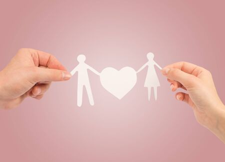 paper family in hands isolated on a white background photo