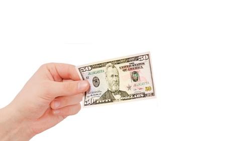 L'argent (en dollars) dans une main, isolé sur blanc Banque d'images