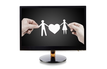 monitor with a paper family in hands isolated on white photo