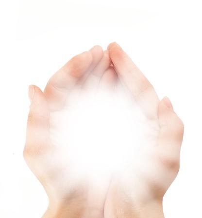 Female hands holding a brilliant shine in the dark Stock Photo