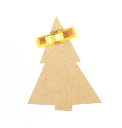 christmas tree made of old paper with a small bow and space for Your text photo