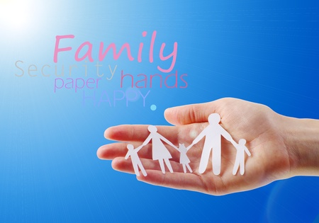 Paper family in hands isolated on blue sky Stock fotó