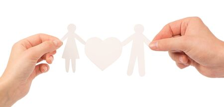 paper family in hands isolated on a white background Stock Photo - 12662840