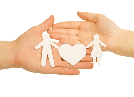 Paper family in hand with a big hearth isolated on white Stock Photo - 12663004