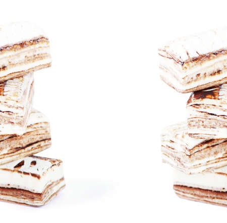 nus: Few pieces of nougat stacked together on white Stock Photo