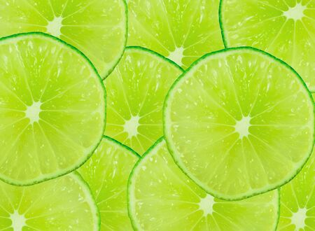Green background with citrus-fruit of lime slices  Close-up  Studio photography  photo