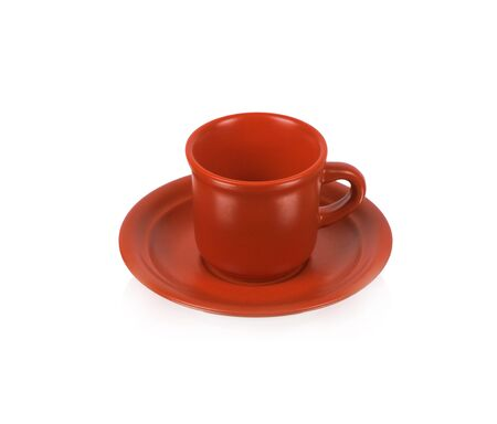 Red cup on a red saucer isolated on white background photo