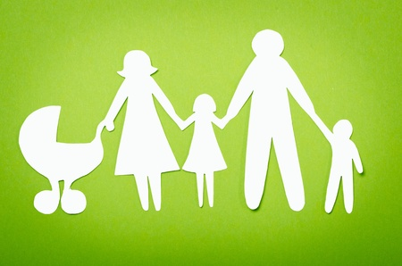 Closeup of paper family on white background photo