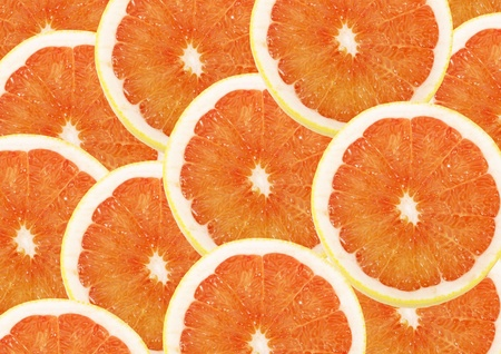 fresh grapefruit and slices background photo