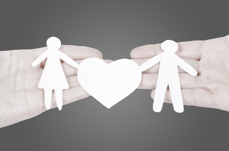 Paper family in hand with a big hearth isolated on white Stock Photo - 12834163