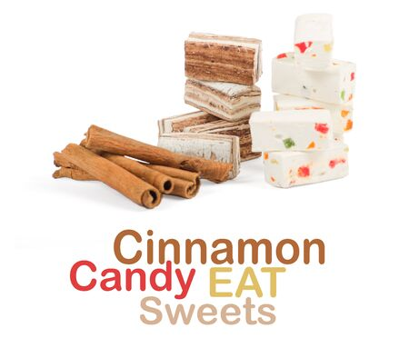 Sweets and cinnamon sticks isolated on white background photo
