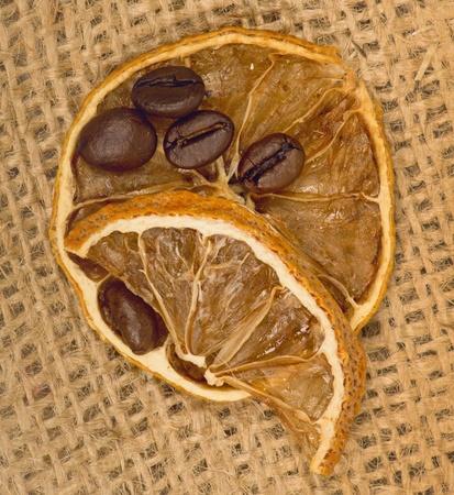 lemons and coffee beans on burlap photo