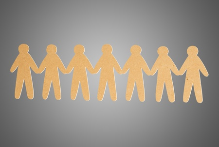 team of paper people on grey background Stock Photo - 13005978