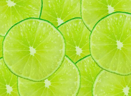 Abstract green background with citrus-fruit of lime slices Stock Photo - 13030122