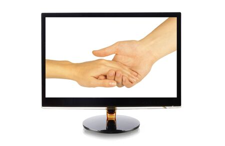 Shaking hands of two people, man and woman, in monitor isolated on white Stock Photo - 13053832