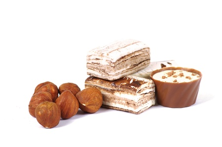 Chocolate and nuts over white photo
