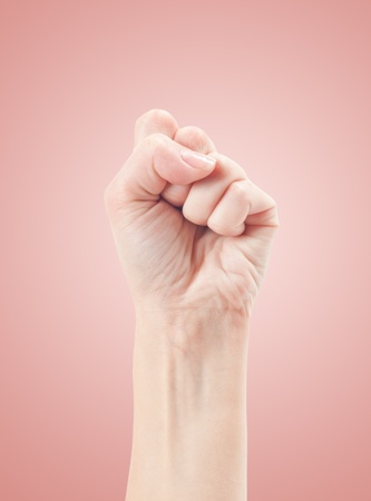 Fist  Gesture of the hand on pink background Stock Photo - 13313809