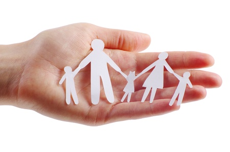 Paper family in hands isolated on white background Stock Photo - 13341454