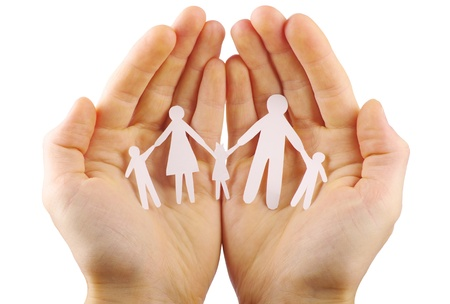 Paper family in hands isolated on white background Stock Photo