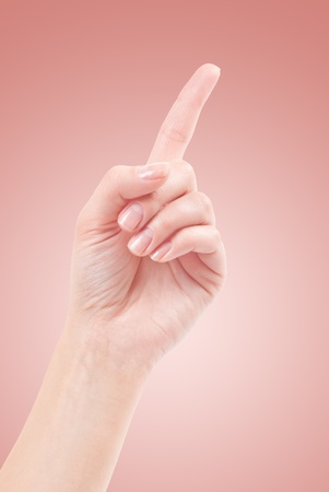 Hand with index finger, isolated on a beautiful background photo