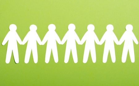 team of paper people on green background Stock Photo - 13450000