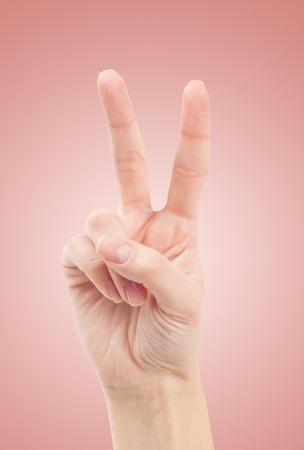 winning bid: Hand with two fingers up in the peace or victory symbol. Also the sign for the letter V in sign language. Stock Photo