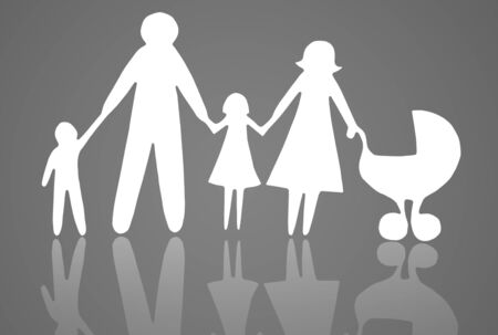 Closeup of paper family on grey background photo