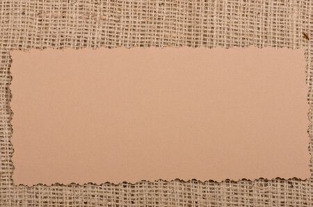 Old paper tag on natural burlap photo
