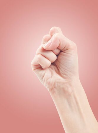 Fist. Gesture of the hand on pink background. Stock Photo - 13603936