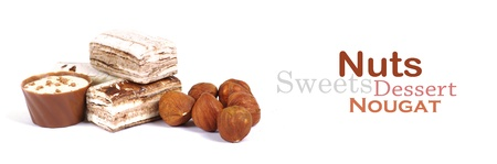 Chocolate and nuts over white Stock Photo - 13651569