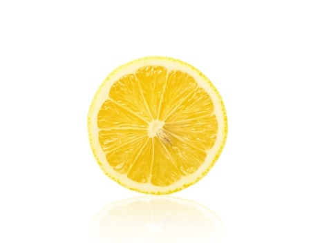 Slice of fresh lemon isolated on white background Stock Photo - 13857482