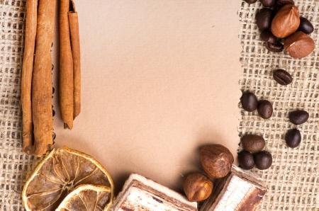 Menu Design. Old paper, coffee bean, cinnamon, lemon, burlap. photo