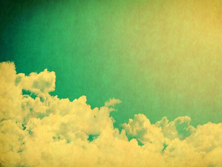 yellowed: Vintage background in the blue shade with clouds Stock Photo