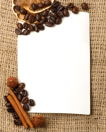 Menu Design.Old paper, coffee bean, cinnamon, lemon, burlap. photo
