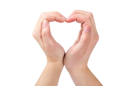 Two hands form a heart shape with their fingers photo