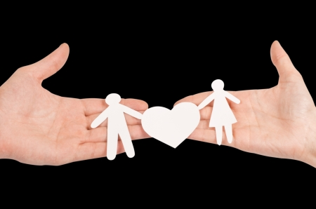 Cutout paper chain family with the protection of cupped hands, concept for security and care Stock Photo - 15694286