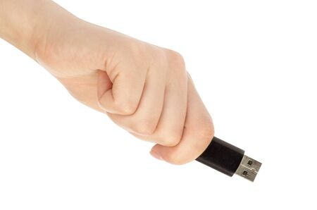 hand with an USB flash isolated over white photo