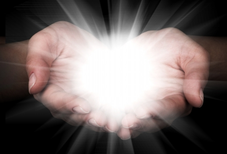 Female hands holding a brilliant star in the dark Stock Photo - 15825528
