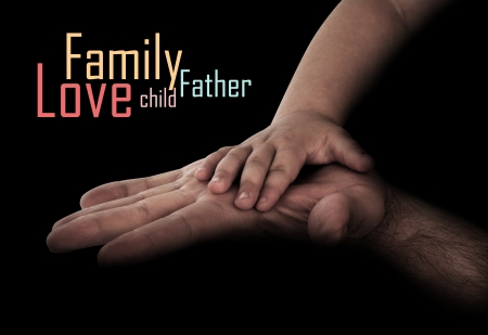 fond of children: baby hand with fathers hand Stock Photo