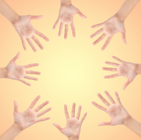 Circle made of hands isolated on beautiful background photo
