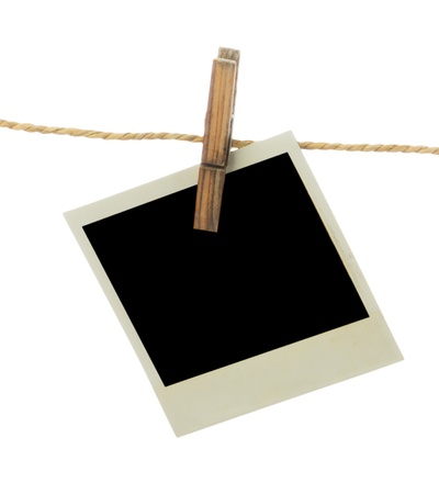 Blank instant photo hanging on the clothesline  Isolated on white background  photo
