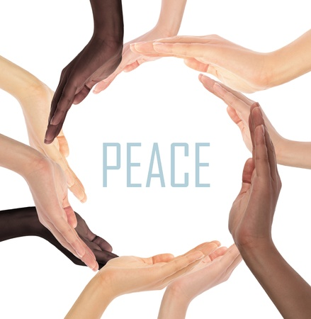 Conceptual symbol of multiracial human hands making a circle on white background with a copy space in the middle Stock Photo - 17235690