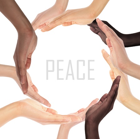 Conceptual symbol of multiracial human hands making a circle on white background with a copy space in the middle photo