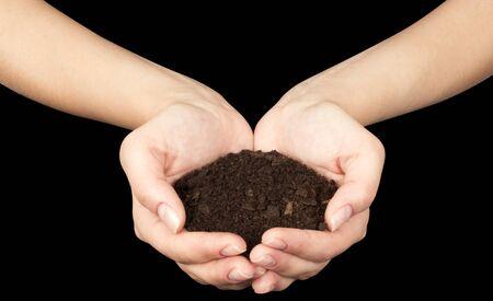 Brown Land and humman hand (on hand) Stock Photo - 17462647