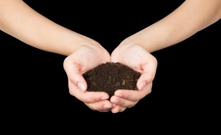 earth handful: Brown Land and humman hand (on hand) Stock Photo