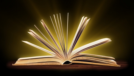 fairytale background: Book  Opened book with special light  Education Stock Photo
