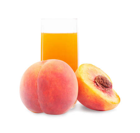 Peach fruit juice in glass isolated on white background  photo