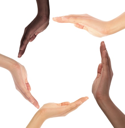 diverse hands: Conceptual symbol of multiracial human hands making a circle on white background with a copy space in the middle